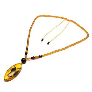 SAUTOIR ET COLLIER TEMPSA Pendentif femme en ambre résine pour amulet
