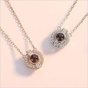 SAUTOIR ET COLLIER Collier pendentif diamant rond 100 langues I love