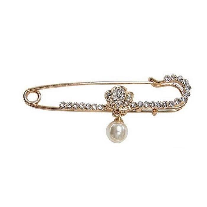 Broche doré style épingle papillon et perle nacrée.