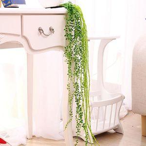 Un salon de jardin maison bar décoration de rue feuille supérieure en  plastique plante décorative (vert)