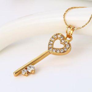 BRACELET - GOURMETTE Pendentif clé élégant 18k en or jaune plaqué coeur