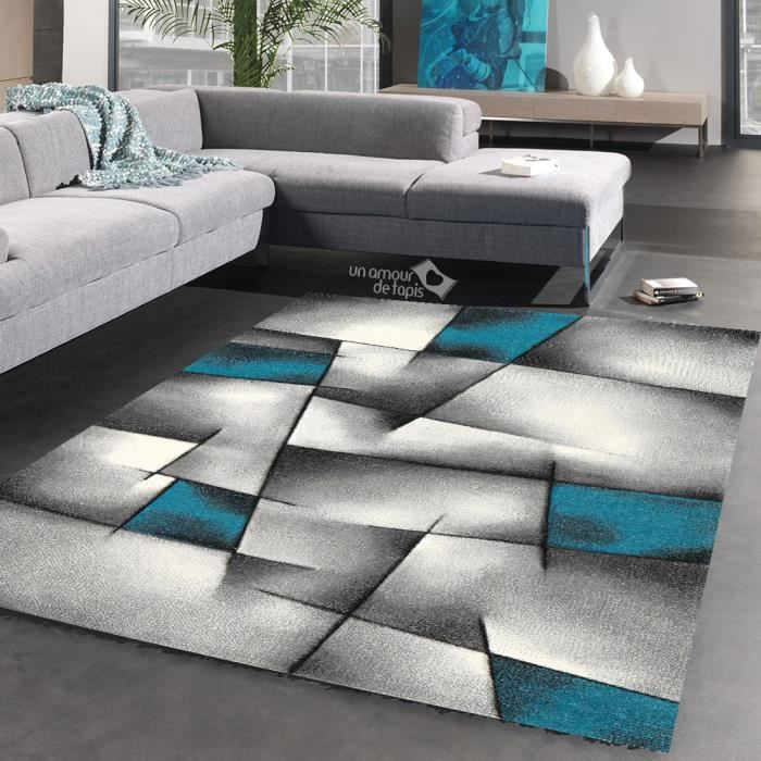 tapis salon design en polypropylene triangula bleu 160x230 par unamourdetapis tapis moderne. Black Bedroom Furniture Sets. Home Design Ideas