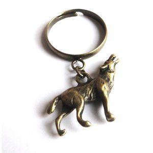 BAGUE - ANNEAU Bague avec breloque loup couleur bronze.