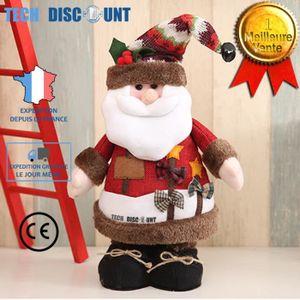 Père de Noël en peluche chantant et claquant des mains