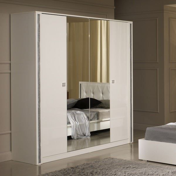 armoire ness 4 portes laqu e blanche moncornerdeco. Black Bedroom Furniture Sets. Home Design Ideas
