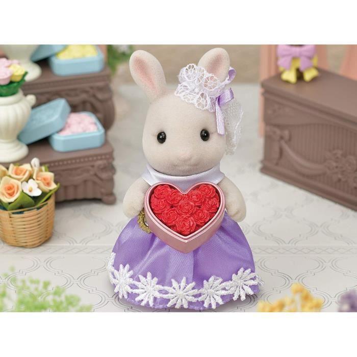 SYLVANIAN FAMILIES - 5369 - La grande sœur lapin crème et son bouquet de fleurs - La ville