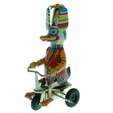canard a helices pedalant sur son tricycle jouet mecanique en fer blanc a cle achat vente. Black Bedroom Furniture Sets. Home Design Ideas