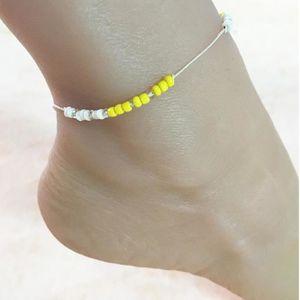 CHAINE DE CHEVILLE Chaîne de cheville perles jaunes ronds pour femme