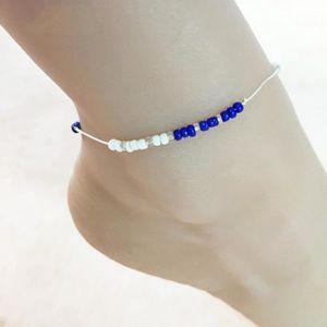 CHAINE DE CHEVILLE Chaîne de cheville perles bleus foncé ronds pour f