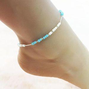 CHAINE DE CHEVILLE Chaîne de cheville perles bleus  ronds pour femme