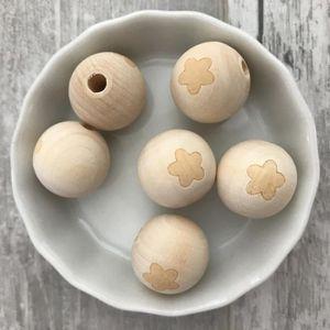 ACCESSOIRES SUCETTE  Perle en bois naturel fleur 20mm, à l'unité