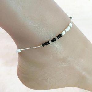 CHAINE DE CHEVILLE Chaîne de cheville perles noirs ronds pour femme