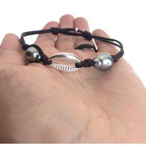 BRACELET - GOURMETTE Bracelet avec deux perles noires de Tahiti bracele