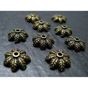 SUPPORTS BIJOUX  40 breloques bronze ref OB8911 coupelle feuille