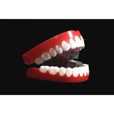 Dentier à remontoir mécanique