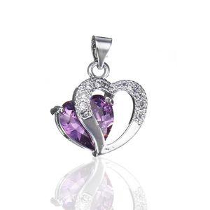 PENDENTIF VENDU SEUL TEMPSA Pendentif femme en forme de coeur cristal a
