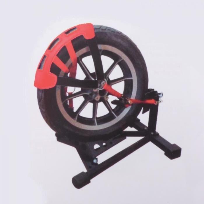 Outillage à sangle qui maintien la roue de moto en appui contre un support