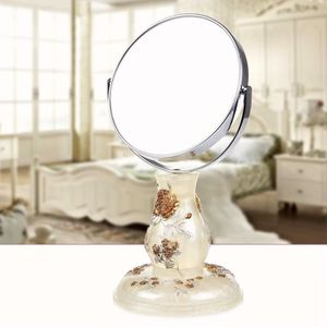 Miroir de maquillage en r sine recto verso 360 tournant for Miroir tournant