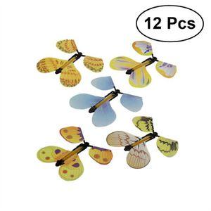 12pcs Papillon Magique Volant Dans Le Livre Fee Caoutchouc Bande Alimente Vent Jouet Papillon Grand Cadeau Surprise Couleur